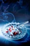 Rökande bytar Arkivbild