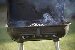 Rökande galler Arkivbild