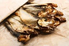 Rökte små stackare i en brun pappers- påse Royaltyfria Bilder