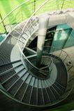 Röra sig i spiral trappan Arkivbild