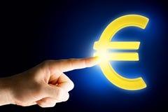 Rörande eurotecken för manlig hand Royaltyfria Bilder