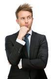 Rörande framsida för fundersam affärsman royaltyfri foto