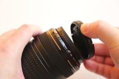 Rörande linslock för hand Arkivfoto