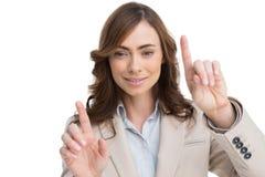 Rörande osynlig skärm för flott affärskvinna royaltyfria foton