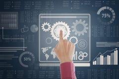 Rörande skärm för affärsmanhand med finansiella data Fotografering för Bildbyråer