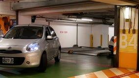 Rörelse av bilen som lämnar underjordisk parkering stock video