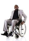 Rörelsehindrat affärsmansammanträde på rullstolen royaltyfri bild