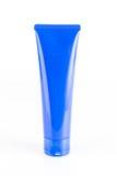 Röret av kräm eller stelnar blå plast- Fotografering för Bildbyråer