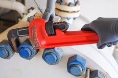 Rörskiftnyckel eller plattångskiftnyckel, hjälpmedelutrustning för bruk i tungt jobb. arkivbilder