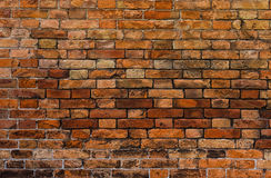 Rötliche Backsteinmauernahaufnahme Lizenzfreies Stockbild