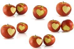 Rött äpple med hjärta på den royaltyfria bilder