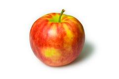 Rött äpple på en vitbakgrund Royaltyfri Foto