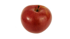 Rött äpple på en vitbakgrund royaltyfria bilder