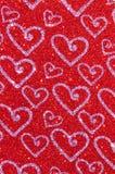 Rött blänka med hjärtatexturbakgrund Fotografering för Bildbyråer