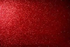 Rött blänka suddig abstrakt bakgrund för bokehljus för valentin, födelsedag, årsdag, bröllop, nytt år och jul Royaltyfri Bild