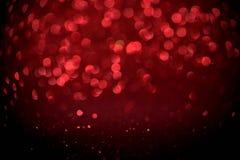 Rött blänka suddig abstrakt bakgrund för bokehljus för valentin, födelsedag, årsdag, bröllop, nytt år och jul Royaltyfri Fotografi