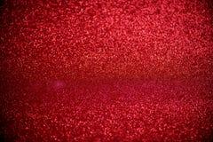 Rött blänka suddig abstrakt bakgrund för bokehljus för valentin, födelsedag, årsdag, bröllop, nytt år och jul Royaltyfri Foto