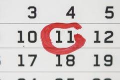 RÖTT CIRKLA Fläck på kalendern på 11 Arkivbilder