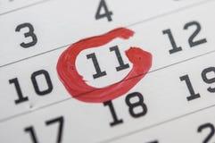 RÖTT CIRKLA Fläck på kalendern på 11 Arkivfoton