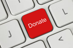 Rött donera knappen på tangentbordet arkivfoto