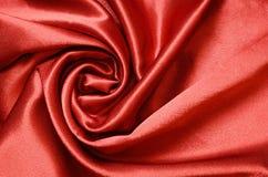 Rött draperat silke royaltyfria bilder
