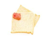 Rött driftstopp målar på bröd Royaltyfri Foto