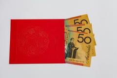 Rött fack med australiska pengar inom royaltyfria foton