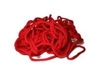 Rött flätat rep som isoleras på vit bakgrund royaltyfria foton