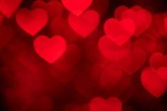 Rött foto för hjärtabokehbakgrund, abstrakt feriebakgrund arkivfoton