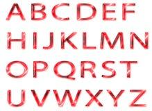 Rött glass alfabet Arkivfoto