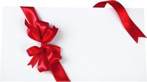 Rött julband på vit bakgrund Arkivfoton