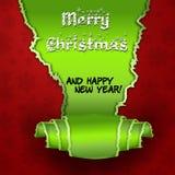 Rött kort med julgranen som göras av rivet papper Arkivbilder