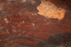 Rött kritisera stenen texturerad bakgrund Fotografering för Bildbyråer