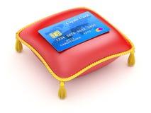 Rött kudde med kreditkorten Arkivbilder