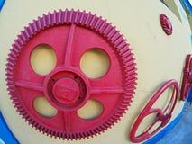 Rött kugghjul Fotografering för Bildbyråer