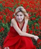 rött kvinnabarn för klänning Arkivfoto