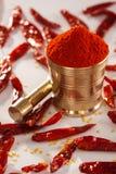 Rött kyligt pulver. arkivfoto