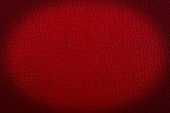 Rött läder en bakgrund. Royaltyfri Fotografi