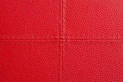 Rött läder med arg sömnadbakgrund Fotografering för Bildbyråer