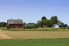 Rött lantbrukarhem Royaltyfri Bild