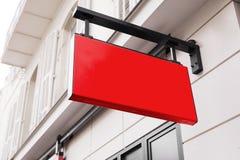 Rött logotecken på väggen Fotografering för Bildbyråer