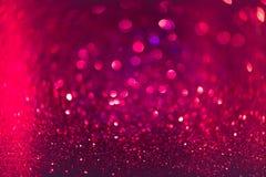 Rött och rosa blänka abstrakt bakgrund med defocused bokeh Arkivfoto