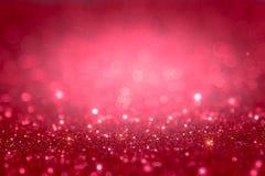Rött och rosa blänka abstrakt bakgrund med defocused li för bokeh Arkivfoto