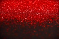 Rött och svart blänka bakgrund Royaltyfria Bilder