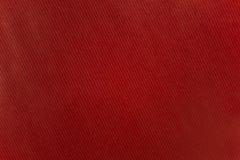 Rött papper med bandmodellen Arkivbild
