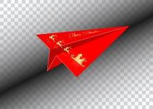 Rött pappers- flygplan, glad jul, guld- Santa Claus med ett renflyg som isoleras Royaltyfria Foton