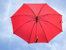 rött paraply Arkivfoto