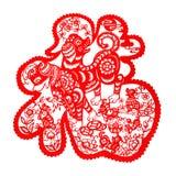 Rött plant papper-snitt på vit som ett symbol av det kinesiska nya året av hunden 2018 Arkivfoto