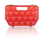 Rött plast- fall för ägg Arkivfoto