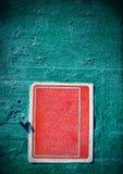 Rött rostigt grungy gammalt tecken med karaktärsteckning på en cementvägg Fotografering för Bildbyråer